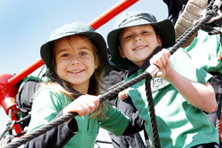 Students climbing play equipment
