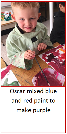 Student mixing paints together.